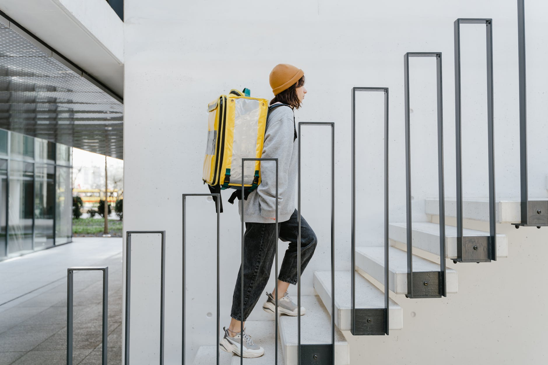 delivery person going up the stairs